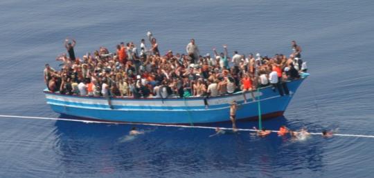 migrants-702x336.jpg